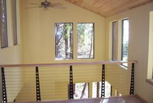 Sea Ranch, California / Chicago Style cable railing.Interior residential balcony railing overlooking great room.