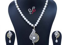 Traditional Yet Fashionable Pearl Necklace Set in White Pearls at Rs.4800