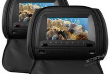 """7"""" Headrest DVD Players from Xtrons / Installed in comfortable faux leather cushions and available in black, grey or beige, Xtrons universal headrest DVD player systems are a great in car entertainment solution, allowing you to easily upgrade without damaging your current cushions. Our 7"""" range is perfect for the average family car and the zip round covers provide excellent security when not in use. Also available at www.xtrons.com and www.xtrons.co.uk"""