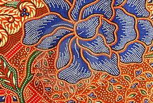 "batik / a complexion of ""malam"" (wax) hand painting on a fabric of a beautiful surroundings phenomenon as petals, clouds, fowl, and so on..."