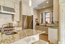 Mad for Mocha / Transitional kitchen cabinets from Woodharbor Custom Cabinetry. U-shaped kitchen features undermount sink and Wolf 6-burner gas range with infrared griddle and dual ovens.