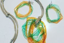 Plastic jewelry by Roberta / Recycling of plastic bottles to create jewerly. Earrings, pendants, rings with alluminum wire and stones by Roberta Recanatesi.