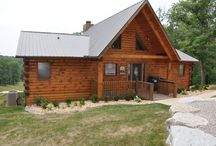 Simpsons Enchanted Hideaway / Simpsons is a wonderful 4/3, 2 Story Cabin with 2 Kings, 1 queen, 2 Twins, 1 rollaway, 1 pull out loveseat. Located near Branson MO. You're just minutes away from all the action!