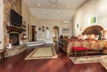 212 Black Point Road, Ticonderoga, NY / This custom-built lakefront home showcases spectacular south-facing views of Lake George that can be savored through the light-filled windows of the spacious, vaulted great room or from the lakefront stone patio with fire pit.  The gently sloping lawn, meticulous landscaping, dock and 110′ of direct water frontage provide for peaceful enjoyment of the tranquil northern end of the lake.