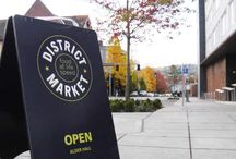 "District Market / In the University of Washington's first venture into the full-service market business, our team worked with the department of Housing and Food Services to create the name and identity for District Market, a mid-size market that's become the heart of the west campus village. Named after the local neighborhood, known as the ""U-district"", the brand design references a classic grocer design aesthetic and honors the modern ""no frills"" approach to the interior and merchandising design approach."