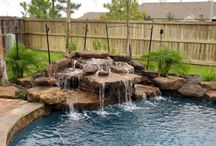 Waterfall, rocks, deck and overall look of pool