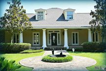 Denham Springs Homes For Sale by Darren James Real Estate Experts / Absolutely stunning home located on 3 acres south of the interstate in Denham Springs. This gorgeous custom home has been completely updated with extraordinary hard wood floors throughout living areas and master bedroom. All of the rooms on the back of the house lead out to the pool area and offer beautiful views. There are four bedrooms downstairs than one upstairs with its own sitting area and bathroom.