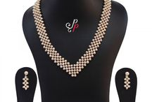 Handknitted dark pink pearl necklace set at Rs. 2,800