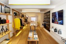 Bywalski store interior - Redchurch Street / We transformed a derelict workshop on Redchurch Street into the London home for Bywalski. A lifestyle brand with its roots in the action sports world. We combined technology with natural materials, flashes of brand colour and our own bespoke lighting to create a modern inviting hang out for the city bound soul-surfer. All display elements are moveable, allowing speedy transformation from retail into an events or gallery space for private views and film screenings.