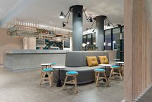 Café Pause Nellingen / The new Café Pause is a flexible, atmospherically contained space, which functions beautifully as a café, but also as a bar and event location. The material and colour concept includes and reinterprets such classic coffeehouse elements as brass and wood panelling.