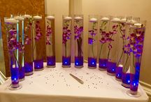 Orchids, floating flowers and candles / Stunning centrepieces in tall vases