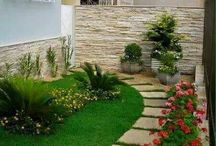 Garden ideas grass and slabs