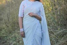 Flower's Breath Gray Sky Pure Silk-Chiffon Embroidered Saree / PRICE INR 10,921/-; US$ 165.00 To buy click here https://www.eastandgrace.com/products/flowers-breath-saree Featuring the Flower's Breath gray sky, pure silk-chiffon saree with a sprinkling of baby pink ribbonwork flowers and eyelet pattern lace detailing along the edges. The blouse is decorated with pink floral embroidery all over and has a small pintuck style bib in the front, with lace edging and a tiny pink ribbon bow. Reach us: care@eastandgrace.com