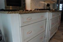 Cumberland Raised Kitchen / Designer:  Craig Teitsma Designer Location: Craig Allen Design, LLC  Specie: Maple Finish: Oatmeal Overlay: FOLC Door/Drawer: Cumberland Raised Fronts: 5pc Flat  Island:  Natural w/ Ebony Glaze