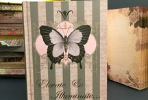 Journal-Notebooks / These gorgeous luxury journals are simply fabulous! They are edged in gold and have a satin ribbon page marker.  The pages are lined and beautifully framed in a vintage rose and bird design.