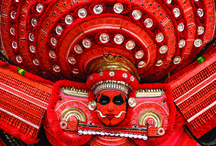Theyyam Festival of Kerala / Theyyam and Thira (Teyyam, Theyyattam ), also known as Kaliyattam is a popular ritual form of worship of North Malabar in Kerala, India, predominant in the Kolathunadu area and in Kodagu and Tulu Nadu of Karnataka.  The Theyyam is a performance art and people of these districts consider Theyyam itself as Gods and they seek blessings from Theyyam.