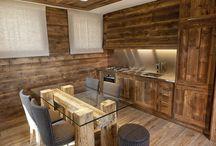chalet d'interni / cucina su misura con boiserie in legno, tavolo realizzato da noi con piano in cristallo e gambe in legno vecchio