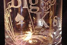 Engraved Glassware / Glassware of various types such as red and white wine, pilsner, and cocktail glasses custom engraved with different designs and layouts