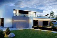 HomeKONCEPT 30 | Projekt domu / HomeKONCEPT-30 to projekt dużego domu o nowoczesnym charakterze. Wyróżnia go wyjątkowa bryła, którą okala unikatowe belkowanie, nadające całości niezwykłego szyku i elegancji. Idealnie skomponowana elewacja utrzymana w tonacji bieli i szarości oraz ciemna stolarka okienna podkreślają modernistyczny charakter budynku. Ogromnym atutem tego projektu są nietypowe, dwukondygnacyjne przeszklenia. Układ okien oraz ich powierzchnia są gwarancją jasnych, pełnych naturalnego światła wnętrz.