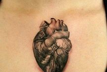 Tattoos  / by Candace Mclellan