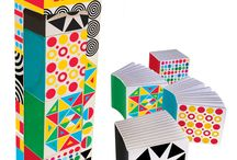 Baby's First Book Blocks / A series of mini board books to develop infants' visual acuity.  Features high-contrast colors, eye-catching shapes, and colorful patterns.