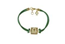 zodiac sign bracelets / A hammered finish zodiac sign gold vermeil plates in hand dyed leather bracelets.
