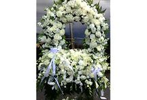 Custom Funeral and Sympathy Tributes / Specialized sympathy flower arrangements that represent a special meaning to family and friends. Custom flower tributes include sport teams, badges and hobbies.