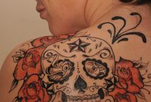 Tattoos / red and black sugar skull tattoo. I'd change the nautical star at the top.