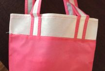 """Tote Bags Pink and White / HOOD'S in West Alton, Missouri has nonwoven bags.  The size is 6 1/2"""" w by 8"""" h x 4"""" gusset and it is washable.  These are good for holding books, crayons, or other school supplies."""