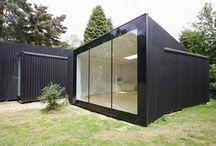 Project: Garden Studio / Twinned garden studios to the rear garden of home in Suffolk using frameless structural glass from IQ Glass. Award winning design from SOUP