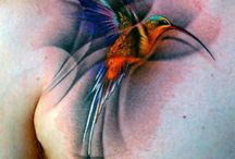 Hummingbird Tattoo / The hummingbird spirit animal symbolises the enjoyment of life and lightness of being. Those who have the hummingbird as a totem are invited to enjoy the sweetness of life, lift up negativity wherever it creeps in and express love more fully in their daily endeavors. This fascinating bird is capable of the most amazing feats despite its small size. Those who have this bird as totem may be encouraged to develop their adaptability and resiliency while keeping a playful and optimistic outlook.