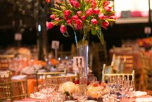 Decor for Corporate Events / A mixture of tall and low centerpieces with seasonal floral.