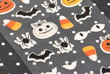Midnight Haunting | Pebbles Inc. / Ghouls and ghosts beware! Pebbles' new collection Midnight Haunting is totally spooktacular. This trendy line is filled with all things Autumn and is perfect for dressing up your big Halloween bash. Pretty leaves and florals, yummy candy corn, and all the nighttime creatures you'd expect on Halloween come together in paper icon shapes, stickers and more to have a ball. With a little help from your batty friends at Pebbles, your Halloween party is sure to be a scream.