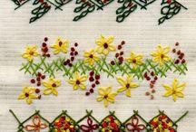 Border stitching eg on tea towels