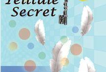 A Telltale Secret / My Debut Novel.