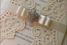 DESIGN: Doyle / Laser cut wedding stationery with ribbon and crystal embellishment.