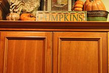 Decor above kitchen cabinets / by Marcy Larson
