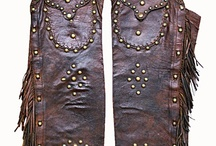 Chapped / chaps |CHaps, SHaps| plural noun 1. leather pants without a seat, worn by a cowboy over ordinary pants to protect the legs.  ORIGIN mid 19th cent.: short for chaparajos. / by Double D Ranch