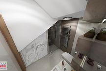 PROJEKT WNĘTRZA ŁAZIENKI W KATOWICACH / Powszechnie wiadomo, że już na etapie tworzenia projektu architektonicznego domu, należy zwrócić uwagę na przemyślane rozwiązania i rozważne wykorzystanie każdej powierzchni. Pomieszczenie łazienki, jaką mięliśmy przyjemność projektować, zlokalizowane zostało w przestrzeni pod schodami, prowadzącymi z parteru na piętro. Wyzwanie? Niewielka powierzchnia i wszechobecne skosy! Efekt? Duża kabina prysznicowa, miska ustępowa, umywalka z szafką i wnęka na pralkę.
