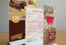 Menu Holders & Menu Stands / Menu holders help to display your menu in an efficient and cost effective manner.  View our range of literature stands here. Can't find what you're looking for? Give our friendly team a call on 01234 240 007!