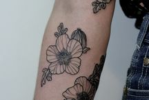Tattoos / by Emily Bethune