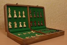 Chess set with wooden storage box - chessbazaar.com / Magnetic chess sets are ideal for playing on planes, trains, buses or in the cars. These chess sets use magnetic fields to secure the chess pieces to the board ensuring that they will not move. The cute magnetic chess sets are perfect for gifting purposes.  In these chess sets, chess pieces are magnetized and a metal plate is fitted under the board. They are very convenient and comfortable.The chess board folds into box that has been fixed with a soft casing with punches slot to put in chessmen.