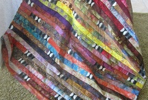 quilts for using jelly roll race tops / by Ann Renica