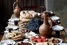 """Bacchanalian Feast / """"Long, low tables were heaped with golden pears, chestnuts, bowls of bread soaking in buttery milk, pomegranates ripped in half and half again, violet petals on crystal plates, and all manner of strange delicacies."""""""