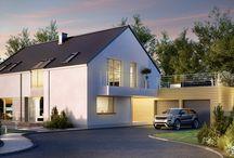 HomeKONCEPT 35 | Projekt domu / HomeKONCEPT-35 to przestronny dom o wyrazistym, nowoczesnym charakterze. Geometryczną bryłę przełamuje wysunięty, dwustanowiskowy garaż. Ciemny, dwuspadowy dach bez okapów kontrastuje z jasnym tynkiem, betonem elewacyjnym oraz drewnem, dzięki czemu dom prezentuje się bardzo stylowo. Zarówno z zewnątrz, jak i wewnątrz domu zachwyca duże przeszklenie salonu i jadalni oraz okno kolankowe doświetlające jedną z przestronnych sypialni na poddaszu.