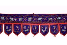 Bollywood Designer Door Hanging www.artingle.com / Toran means pass of a sacred gateway. Made from wood or stone in olden days, it is a decorative door hanging used even today in Indian homes. Made in cloth with decorative beads, shells, mirror etc a toran decorates the entrance of our homes invoking the holy spirits to enter our homes and bless us. It is also considered to be an integral part of decoration specially on occasions and celebrations like weddings, festivals and auspicious poojas.