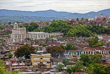 """Santiago de Cuba / The bustling southeastern port city, the island's second largest, boasts sweeping hills and turquoise waters, the Casa de Diego Valezquez (oldest home in Latin America), and the citadel of San Pedro de la Roca, which smugly reigns as the UNESCO World Heritage list's """"best-preserved example of Spanish-American military architecture."""""""