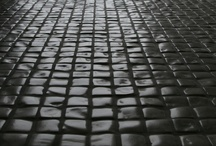 """Timeworn / Italian ceramics are once again redefining """"timeless"""" with tiles that look like they have existed for decades—even centuries! In some of their latest collections, companies took the popular material look-alike trend and infused its surfaces with the wear from thousands of footsteps and a little bit of Mother Nature's fury."""
