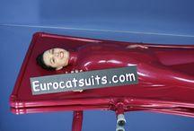 Latex vacbed with sleeves - solo play possible / with this vacbed from Eurocatsuits , you no longer need outside help to enjoy vacuum bondage in latex .