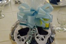 Custom baby party centerpieces / These centerpieces were designed for a baby's arrival party. Different items were put into the basket centerpieces that the baby could use after the Buffalo Grove, IL, party was over.